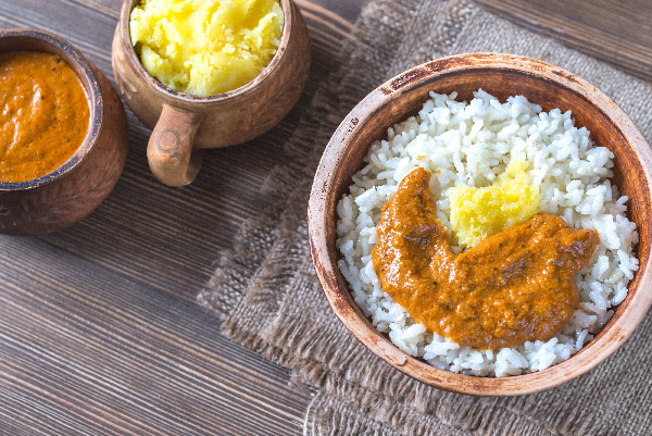Bowl of rice with Indian butter sauce and Ghee clarified butter